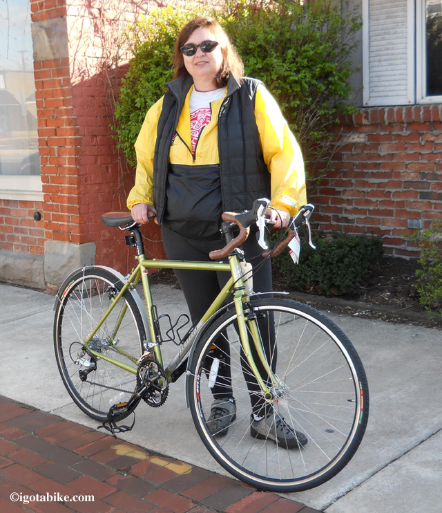 Here's Carol outside the bike shop after purchasing a new 2010 Jamis Aurora touring bike in April 2012.     Wow! What a pretty bike!
