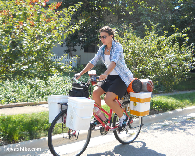 Sarah is pedaling her way from Mississippi to Maine. She says her homemade plastic bucket panniers work great and keep all her stuff dry. They also help to keep the critters out of her food while camping.