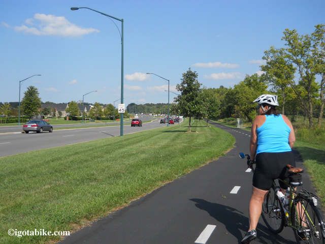 The bike trail on the south side of Maxtown Road / Polaris Parkway which connects to the Alum Creek Trail via Cleveland Avenue. In this photo Carol is facing east, following the northbound Ohio to Erie Trail.
