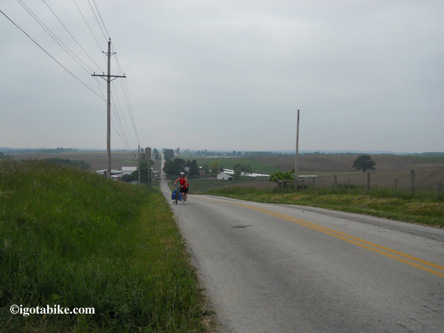 Chris will be riding Route 6 today. This photo shows Carol pushing her loaded Jamis Aurora up on of the more memorable hills in May 2012.