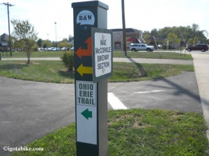 "When we rode through Columbus in August 2012 we saw many new posts that ""appear"" to be marking the turns in the trail. They are green, metal, 4 x 4 posts, about chest high. This one included stickers for the Ohio to Erie trail but all others were blank."