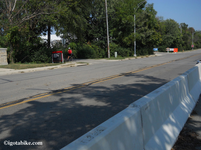Following the detour along W Dodrige Street, you will be behind a temporary concrete wall for 500 feet and you will turn left into Schiermeier Olentangy River Wetland.