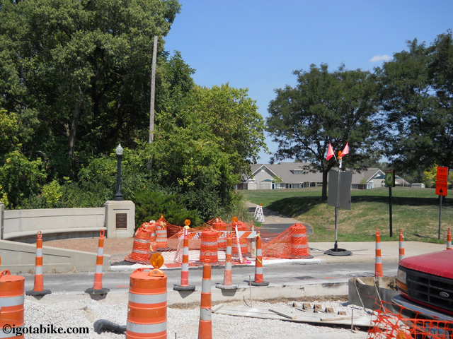 In August 2012 the bridge crossing West Third Avenue along the Olantangy Trail was under contruction. Continue north following the detour around the block, and after construction continue through the tiny Harrison North Park pictured here.